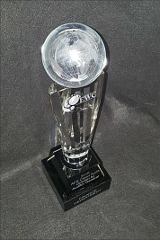 Fluted crystal pedestal with a lasered world ball